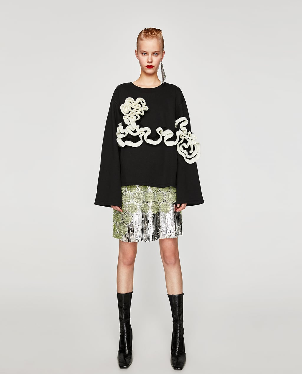 Image 1 of SWEATSHIRT WITH KNIT RUFFLE DETAIL from Zara
