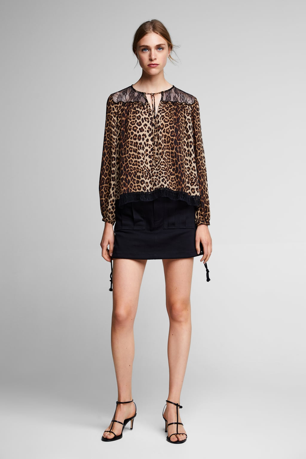 Image 1 of CONTRASTING ANIMAL PRINT TOP from Zara