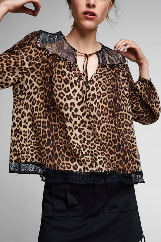 Image 2 of CONTRASTING ANIMAL PRINT TOP from Zara