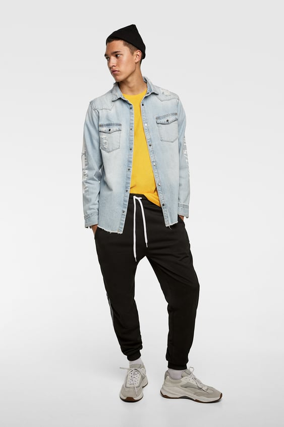 4f837d619bf Image 1 of DENIM OVERSHIRT WITH PRINT DETAIL from Zara