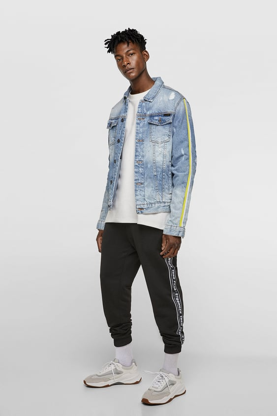 174ef4d7bd Image 1 of RIPPED DENIM JACKET WITH SIDE TAPING from Zara