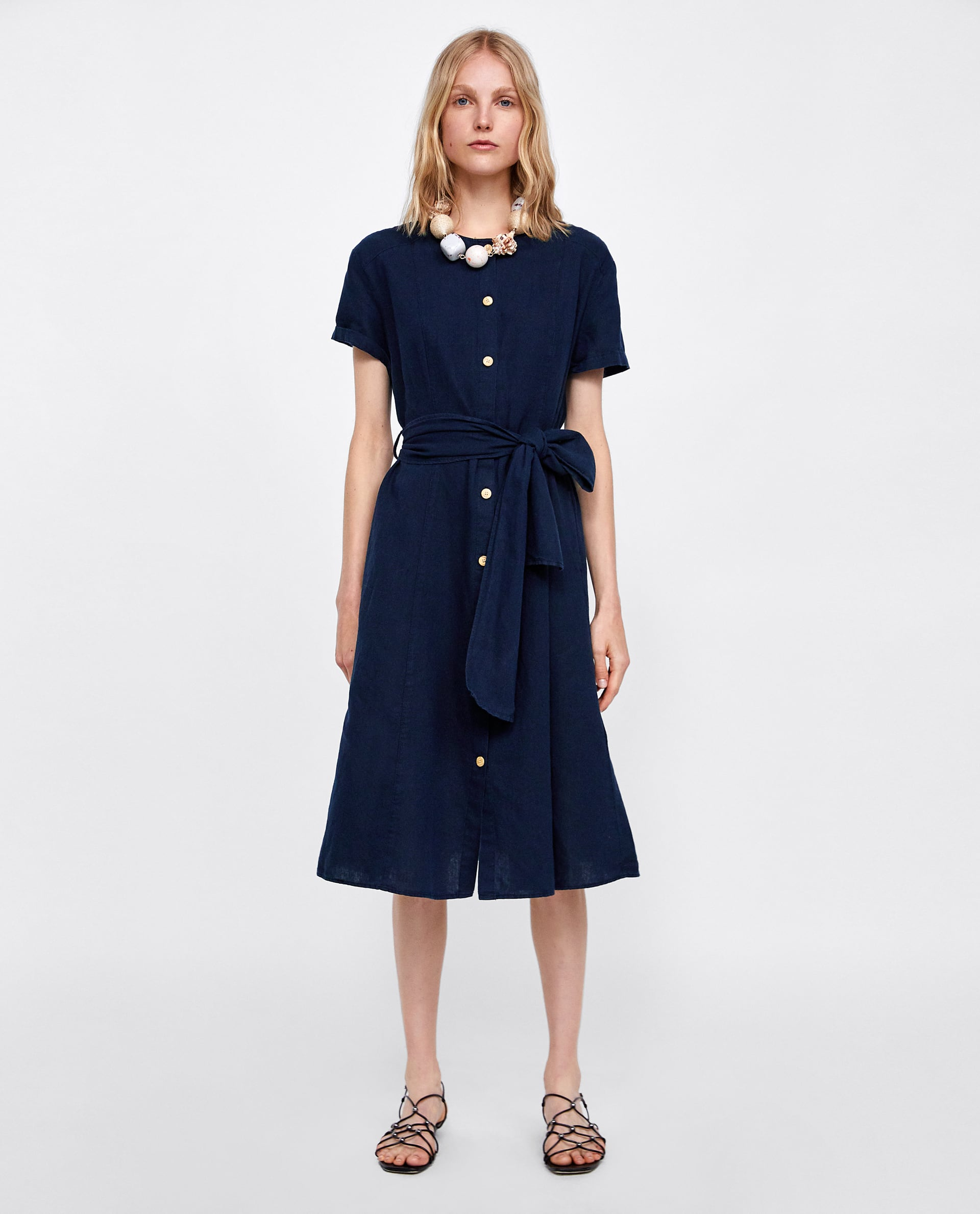 Image 1 of DRESS WITH BOW AND BUTTONS from Zara