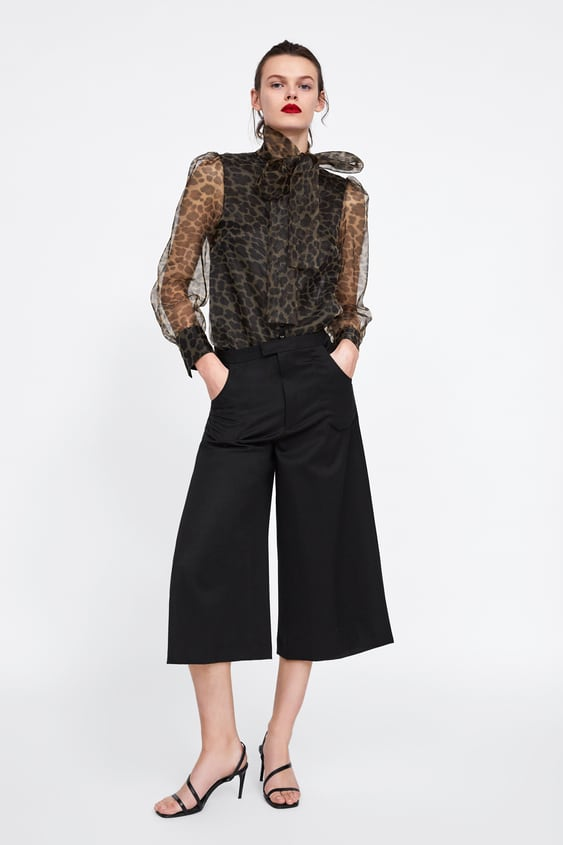 Image 1 of ANIMAL PRINT BLOUSE WITH BOW from Zara 823f575da