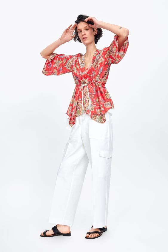 9ff204a088d6f Image 1 of PRINTED BLOUSE WITH DRAWSTRING from Zara