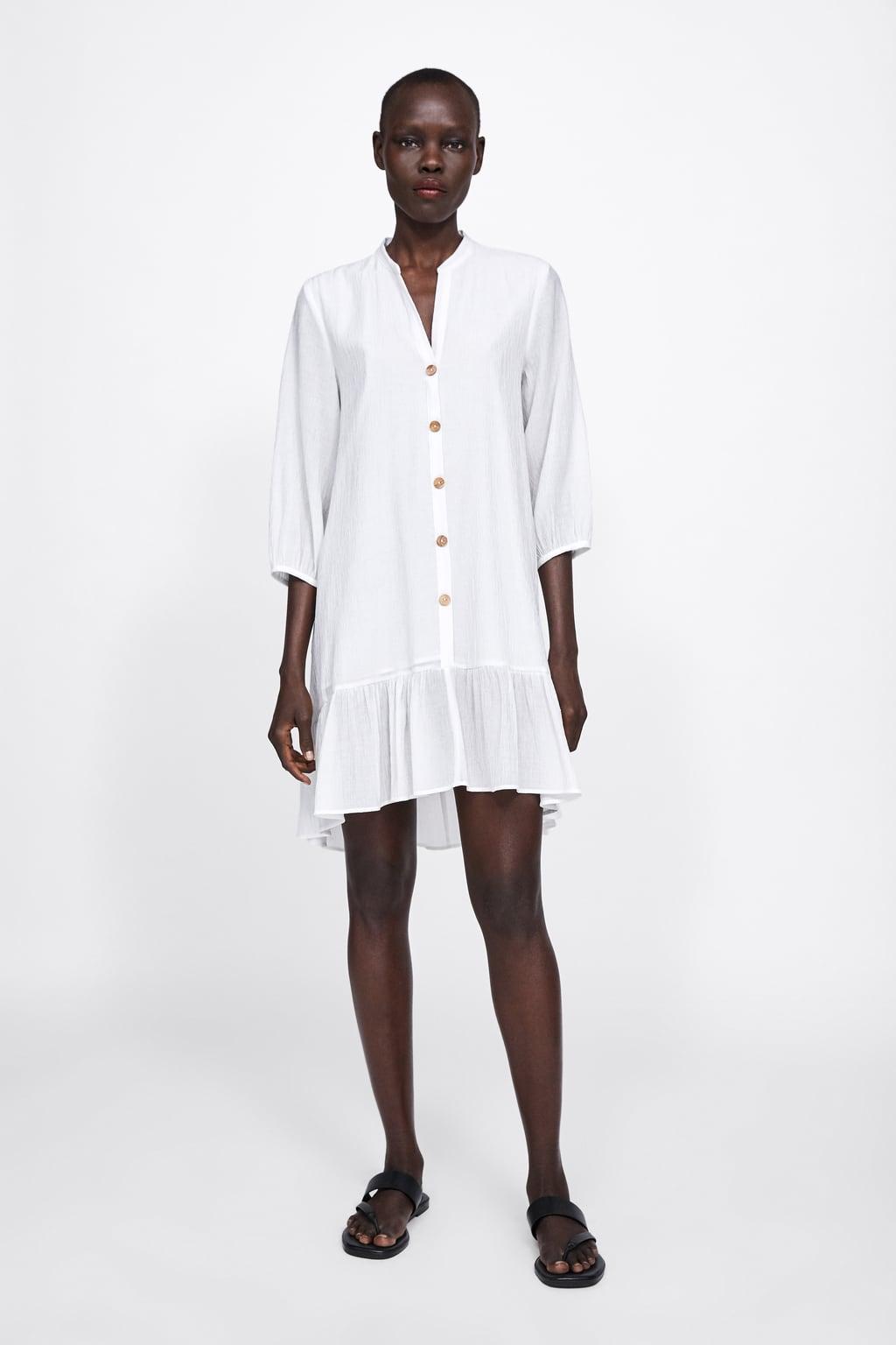Immagine 1 di VESTITO TEXTURE CON VOLANT di Zara
