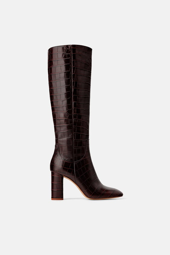 4d7110a1e90 Image 1 of ANIMAL PRINT LEATHER HEELED BOOTS from Zara