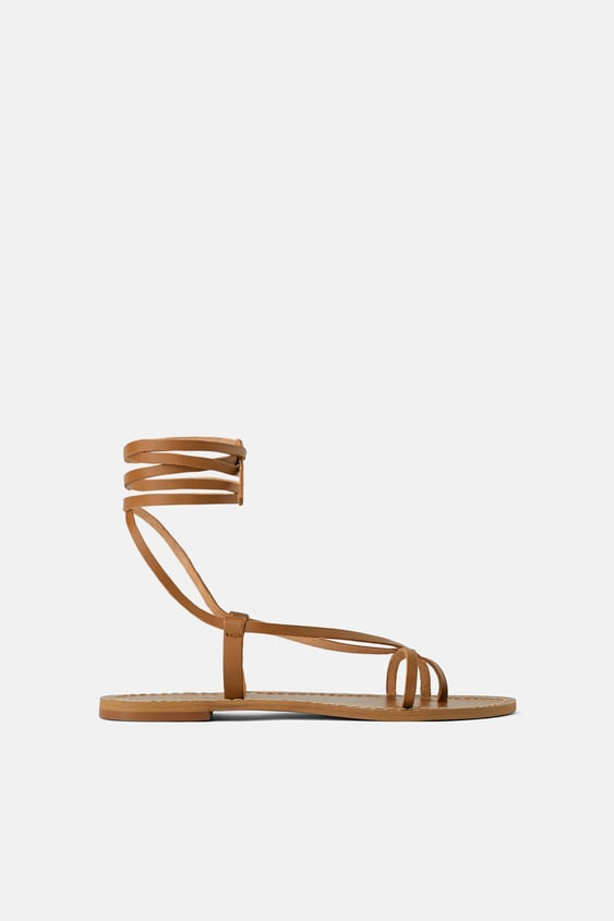 121ba72337df FLAT LEATHER SANDALS WITH CRISS-CROSS STRAPS