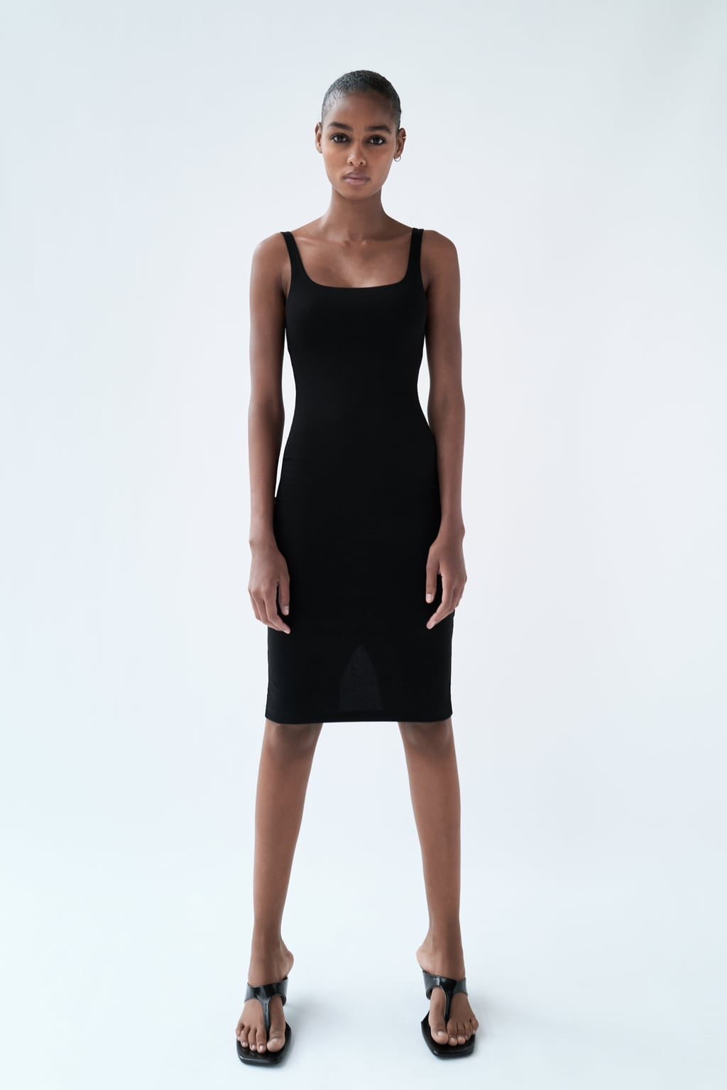 Fitted round neck dress with straps. Back vent.