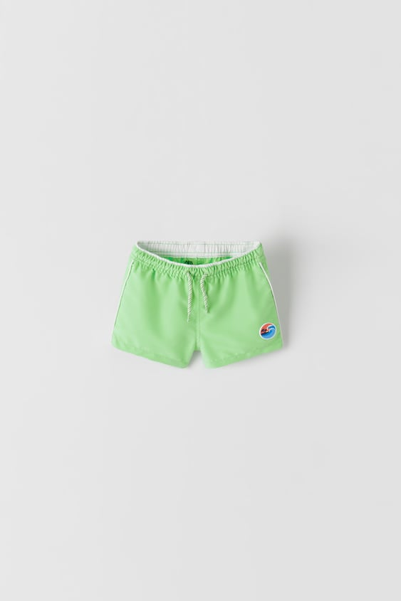 SWIM SHORTS WITH PATCH
