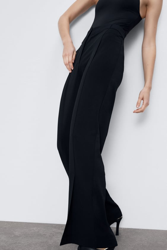 TROUSERS WITH FRONT VENTS