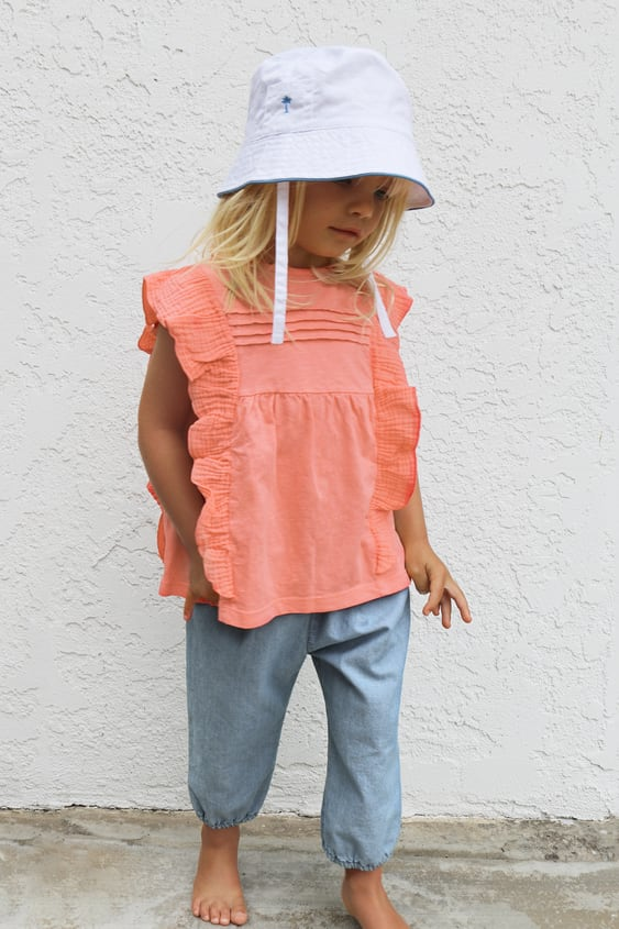 T-SHIRT WITH RUFFLES AND PLEATS