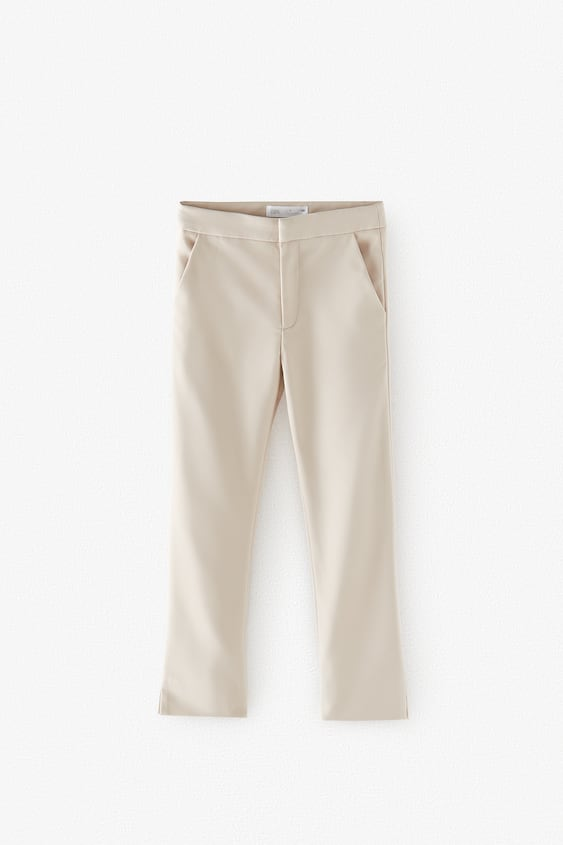 CROPPED TROUSERS WITH SLITS