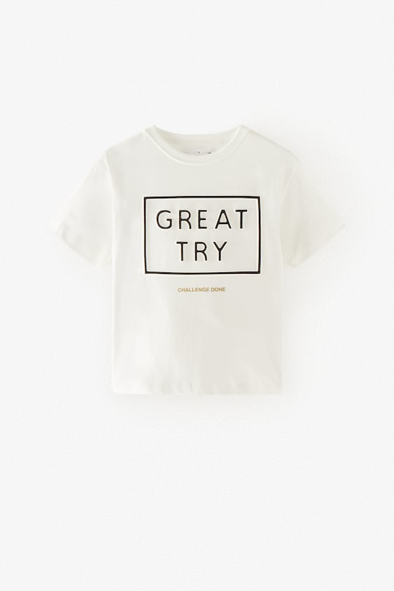 T-SHIRT WITH EMBOSSED SLOGAN