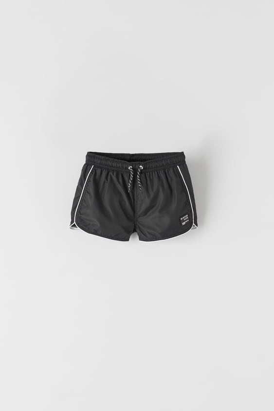 BERMUDA SHORTS STYLE SWIMMING TRUNKS WITH CONTRAST PIPING