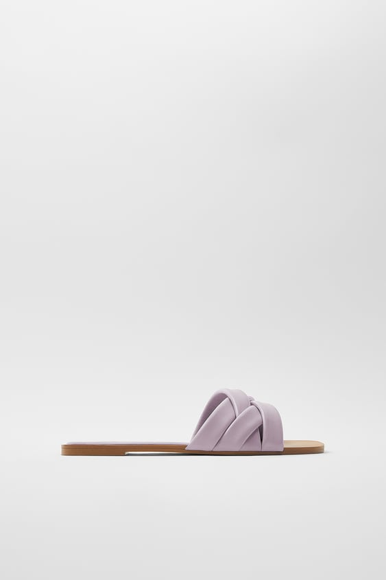 FLAT LEATHER SANDALS WITH QUILTED CRISS-CROSS STRAPS