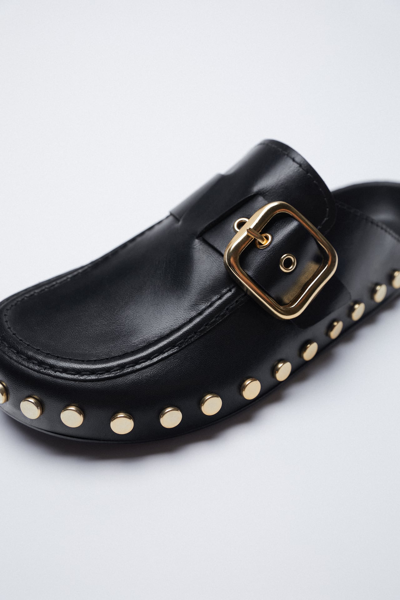 Image 4 of FLAT LEATHER CLOGS WITH STUDS AND BUCKLE from Zara