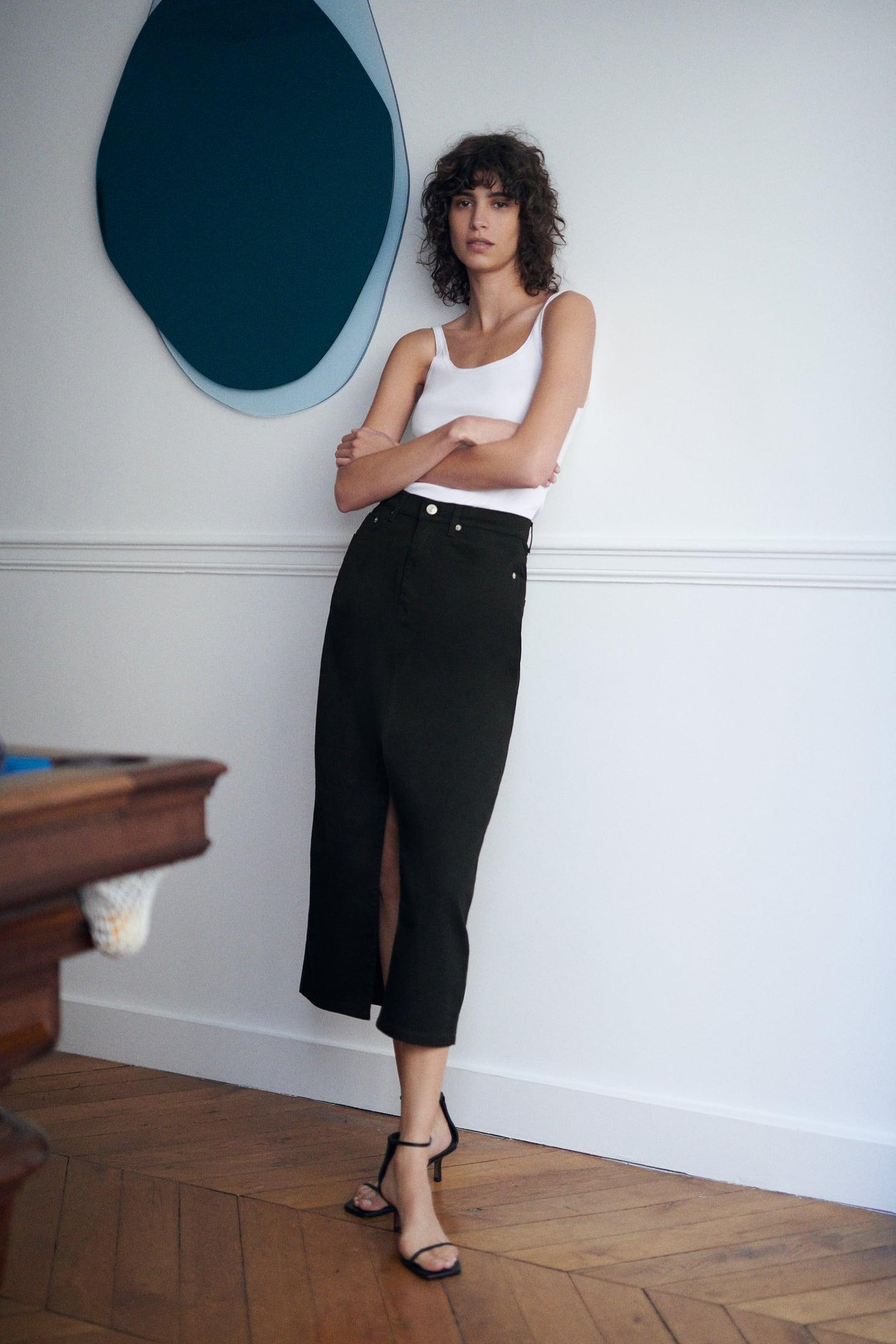 Falda midi negra cinco bolsillos de Zara