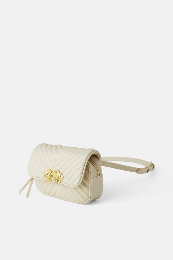 CROSSBODY BELT BAG WITH LIONHEAD DETAIL