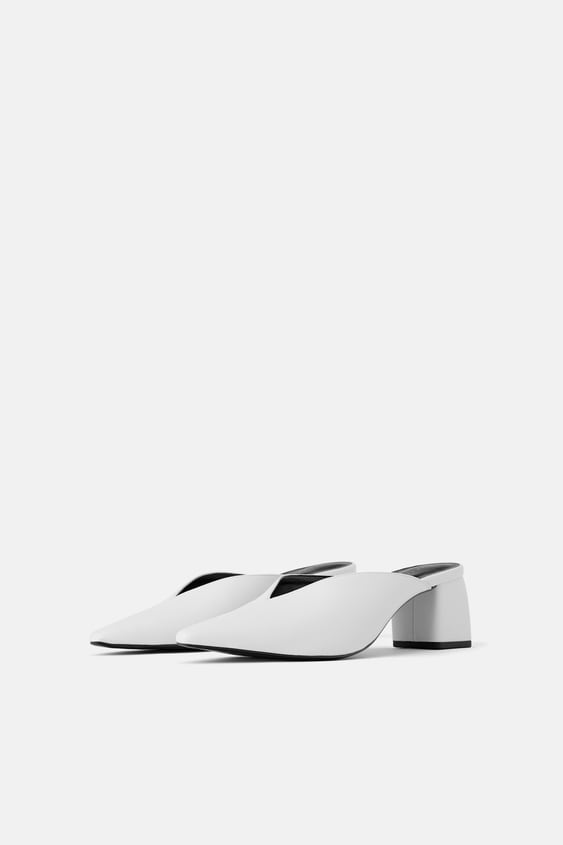 LOW CUT HEELED MULES