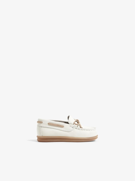 LEATHER LOAFERS WITH TIE DETAIL